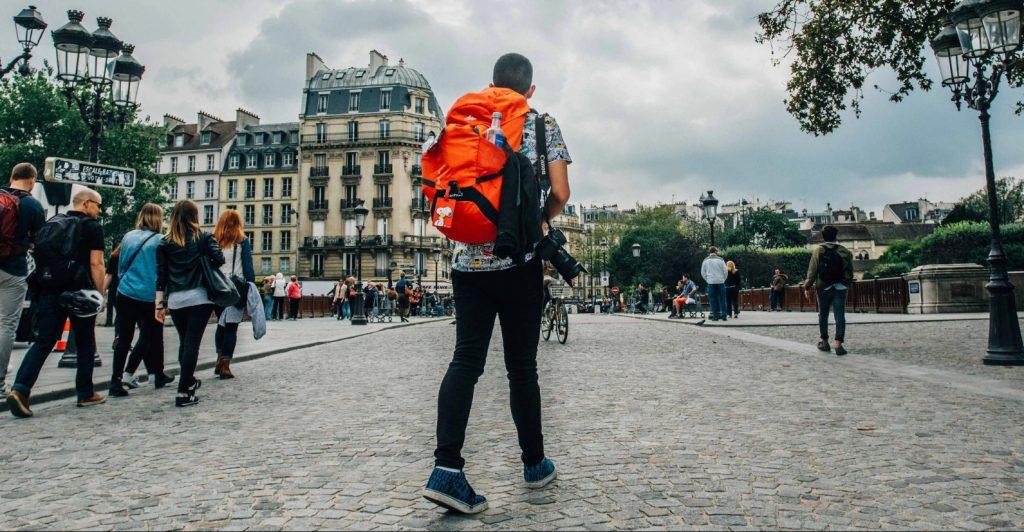Backpacker or budget traveler exploring a city