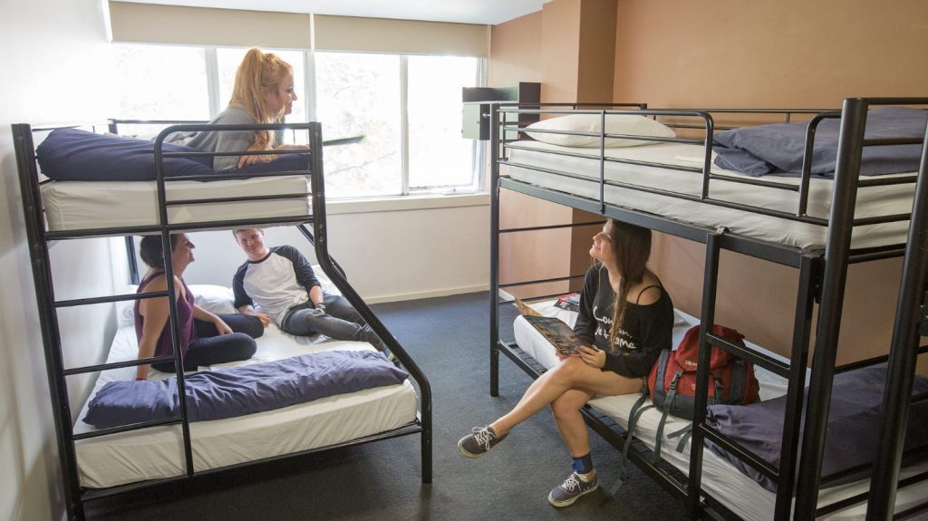 Young women at a shared room of a hostel